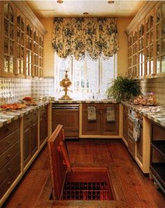 French Country Galley Kitchen french country kitchen. mantel over stove. rustic cabinets