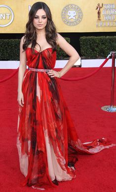 Mila Kunis walks the red carpet at the 2011 Screen Actors Guild Awards in Los Angeles. What Mila is wearing: Dress: Alexander McQueen / Jewelry: Cartier