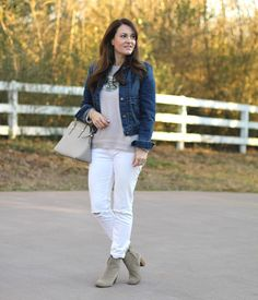 Distressed white denim, denim jacket and pink sweater combine to create the perfect early spring outfit.