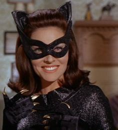"""Costume: I like the ears, mask and """"rolled"""" hair. black gloves with gold nails: neat but unnecessary."""