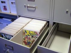 Comic storage in legal sized filing cabinets - lots of space and inexpensive if you buy second hand! Plus kinda industrial ;P