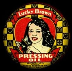 """source of info from www.luckymojo.com """" Black History Month Make-up Facts  This Lucky Brown Pressing Oil tin came out of a warehouse trove in Chicago and was never used. It is about 4"""" in diameter and 3/4 inch tall printed in a limited palette of black red and yellow and in size and shape it vaguely resembles a tin of shoe polish. The image is that of a beautiful young black woman -- or rather a beautiful young woman with African facial features and Caucasian skin colour -- in a bright red…"""