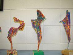 Wire hanger/pantyhose sculpture with splatter paint