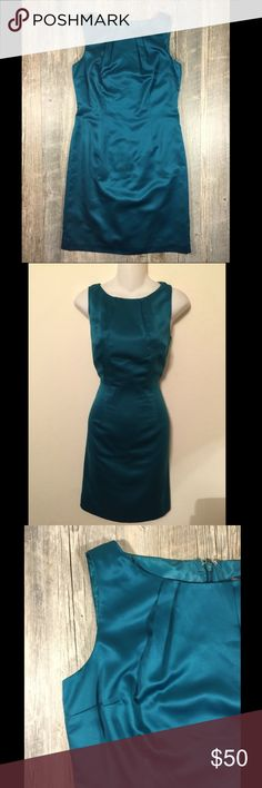 NWT teal green silky dress NWT teal green silky dress. Zipper in back. Polyester. 35 1/2 inches long. Ann Taylor petite size 4P. Ann Taylor Dresses