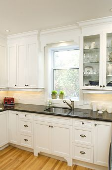 Dark counter, light wood floors, colored backsplash...id paint the cabinets white but I am afraid of the dirt