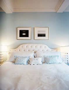 Love the light blue master bedroom walls. White bedspread. Use different throw pillows to add color.