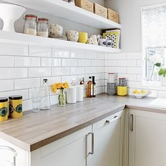 Small kitchen Tiles - White kitchen with metro tiles and open shelves. Small White Kitchens, Gray And White Kitchen, White Kitchen Decor, New Kitchen, Cool Kitchens, Kitchen Yellow, Kitchen Wood, Kitchen Modern, Grey Yellow Kitchen