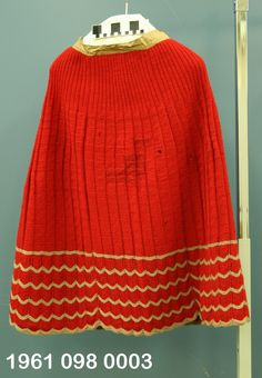 Knitted wool petticoat ID'd as 1860s, but probably later. This petticoat uses the same lace border as the knitted petticoat in an 1864 issue of Godey's, but with 12 rows of lacework between the scallops rather than 8. Missouri History Museum.