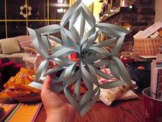 3-D snowflakes! One of my former students taught me how to make these and I am going to teach my students how to make them this year. These can be HUGE if you make them with large paper and look very nice. For a fun variation you could use multiple colors of paper (light blue, silver, and white look really nice together) and/or accent with liquid glitter. Great decoration, accent, or present topper, and a nice change from a typical paper snowflake.