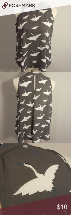 Sleeveless Geese Top Fun and classy grey top with geese pattern. Sleeveless, flower, and comfortable. LOFT Tops Blouses