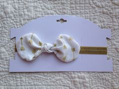 set of 2 gold and off white bows, gold arrow bow, gold polka dot bow, fabric bow, knot bow, rounded knot bow, arrow fabric, by LilacAndMarigold on Etsy https://www.etsy.com/listing/478565596/set-of-2-gold-and-off-white-bows-gold