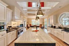 African Rainbow Leather Finished Granite (or Similar)on The Island Counter  Top And A