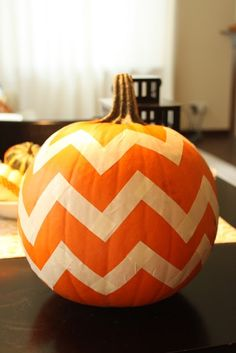 """Charlie Brown Pumpkin ~ Use tape to make the stripes then paint the pumpkin black. When dry, remove tape & you have your """"It's A Great Pumpkin Charlie Brown""""!"""