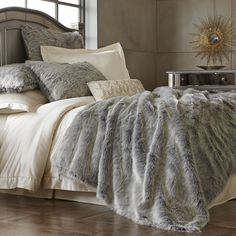 Faux fur, real luxury: Spoil yourself in the indulgent comfort of Pier 1's Gray Ombre Faux Fur Blanket and Shams.