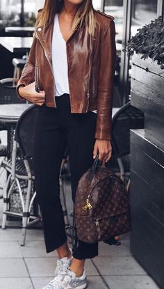 Brown Leather Jacket + Cropped Black Pants + White Sneaker                                                                             Source