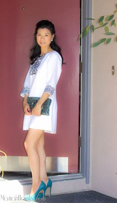 Donna Morgan Helena dress. Black & white tunic.  Kate spade snakeskin clutch. Prada teal pumps.