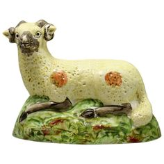 View this item and discover similar for sale at - Antique English Staffordshire pottery figure of a ram early century. This figure is very decorative and appealing with his pale yellow coat with orange Vintage Pottery, Vintage Ceramic, Pottery Art, Ceramic Clay, Porcelain Ceramics, Staffordshire Dog, English Pottery, Ceramic Animals, Ancient Art