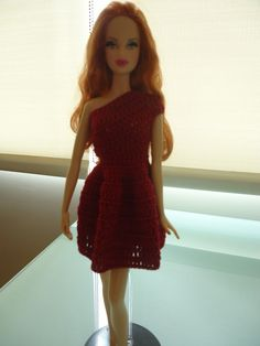 """Did this one shoulder dress for my nieces birthday gift """"closet of crocheted barbie clothes"""" I did this one is pale pink."""