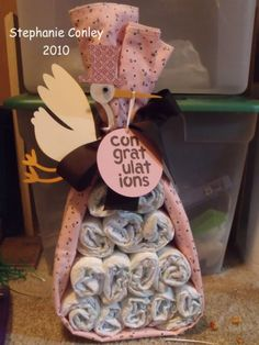 "Made from a baby towel and diapers are inside. A cute alternative to the ""diaper cake"""