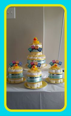 Beautiful Unisex 2 Tier Center Piece Cake with 3 Mini cakes included    Unique and simply beautiful. Cake has a total of 50 disposable size 1