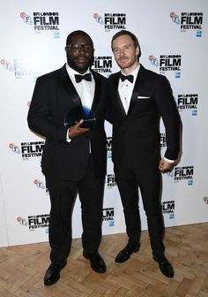 Michael Fassbender Photos Photos - Director Steve McQueen with his BFI Fellowship award with award presenter Michael Fassbender attends the BFI London Film Festival awards during the 60th BFI London Film Festival at Banqueting House on October 15, 2016 in London, England. - BFI London Film Festival Awards - 60th BFI London Film Festival
