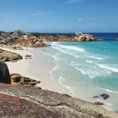 On Tasmania's East Coast the water here is unbelievable and folks will maybe even think this is from some exotic tropical island. It isn't, it is better. Unpolluted. uncrowded, and the rocks add colour and shelter to the many swimming spots. Image credit: Jodie Griggs