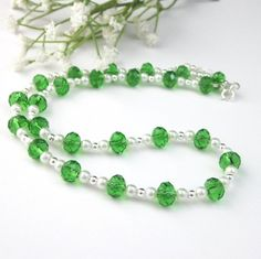This beaded necklace is made with sparkling Venezia Italian emerald green faceted rondell crystals, milky white glass pearls, and small sterling silver beads. The short necklace is adjustable with...@ artfire