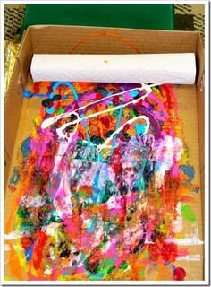 Encourage children to squeeze paint int box [ use paper underneath]  and then roll with a cardboard tube covered with sheet of kitchen roll. Then use roll to create another print. the pained rolls can be suspended and dispalyed too.