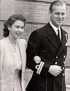 """An officer and a princess.  Royal Navy officer Philip Mountbatten with his fiancee, Princess Elizabeth of York.  The couple's engagement was officially announced on July 10, 1947.  Shortly before then Philip had renounced his Greek and Danish titles, had adopted """"Mountbatten"""" as his surname, and had become a naturalised British citizen."""