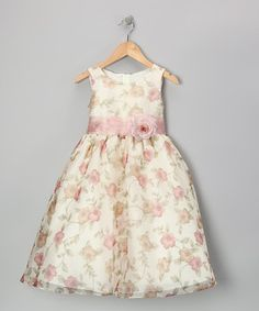 This bright dress recalls the fresh beauty of a blooming field. A fashionable sash gives it shape, and a flower at the waist completes this charming gown.