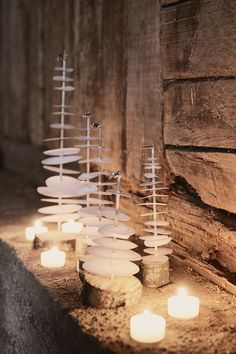caisak.: DIY | PAPPERSGRAN - (smb:  The paper idea is cute, but I could also see stacks of drilled sea shells in the place of the paper discs.)