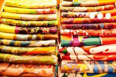 i'm a sucker for a row of hermes scarves. so pretty.