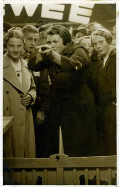 """In 1936, 16-year-old Ria van Dijk from Tilburg, Holland, fires a gun in a fairground shooting gallery. She hits the target, triggering a camera to take her portrait as a prize."" She did this annually until she was 88."