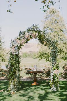 floral wedding ceremony arch @weddingchicks