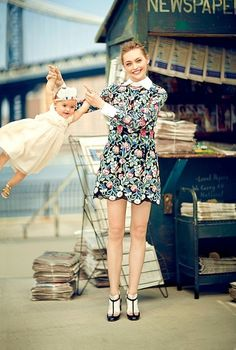 Sasha Pivovarova poses in a floral Valentino dress with daughter Mia Isis