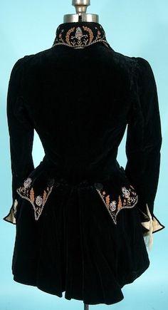 Embroidered silk and black velvet walking jacket (Back). 1884