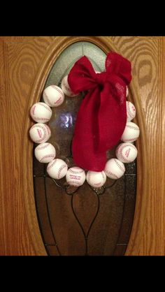 Baseball wreath with just a wire hanger, baseballs with a hole drilled through and a burlap bow!