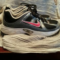 Nike shoes Pair of nikes size 8.5 these are used and show some signs of wear, the toe area of shoes have a couple small scuffs as shown in pic 2..still in pretty good condition other than that Nike Shoes Athletic Shoes