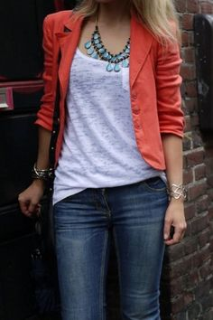 orange blazer jacket blue jeans white top shirt bracelet necklace