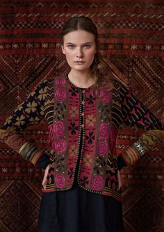 Lavishly embellished knit jacquard cardigan with a machine-embroidered border of roses. A fabulous pattern of flowers and leaves, dots and stripes. Features a V-neck, full-length sleeves and finely detailed edging.