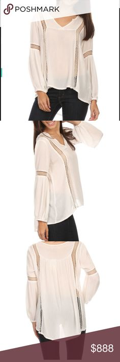 PRETTY CREAM TOP BUST ACROSS LAYING FLAT 21. Cotton top. Hi low.  Longest 26 inches. Elastic at wrists. New w tag. Tops