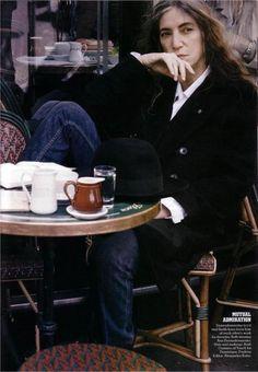 Patti Smith drinking coffee.