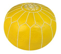 This hand stitched Yellow leather pouf with white silk embroidery will coordinate with any décor. This beautiful yellow Pouf will add a nice design element to any room.  To add a bright pop of color to a study or office, use it as a leather footstool. Imported from Morocco.