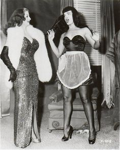 "Tempest Storm and Bettie Page, who starred together in Irving Klaw's 1955 fetish film ""Teaserama."""