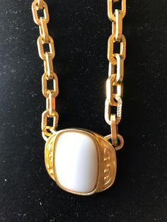 Gorgeous Yves Saint Laurent cream colored pendant in a matte gold-tone (or gold-plated) setting on a richly textured chain. Ysl, Yves Saint Laurent, Vintage Designer Clothing, Matte Gold, Deco, Vintage Outfits, Pendant Necklace, Chain, Jewelry