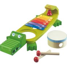 This playful reptile with a colorful bell, removable drum and pair of mallets helps foster musical development and rhythm while honing fine motor skills. Style Name:Haba Symphony Croc Xylophone Set. Style Number: Available in stores. Figurines D'action, Lego Ninjago, Toddler Instruments, Musical Instruments, Instrument De Percussion, Organic Baby Wipes, Kids Toys Online, Best Baby Toys, Musical Toys