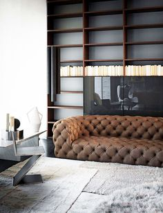 Living Room Space ~ Masculine interior with cushy soft leather tufted sofa, 'Z' side table with wall of shelving. Beautiful Interior Design, Beautiful Interiors, Modern Interiors, Sofa Design, Furniture Design, Interior Architecture, Interior And Exterior, Living Room Designs, Living Spaces