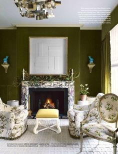 mossy velvet walls, marble fireplace surround, white chintz upholstery, pops of turquoise & yellow, and contemporary art & lighting. Veere Grenney