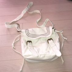 White crossbody bag 2 pockets on front. 2 pockets and zipper inside Bags Satchels