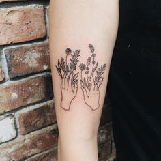 Floral hands tattoo by Olivia Harrison.                                                                                                                                                                                 More